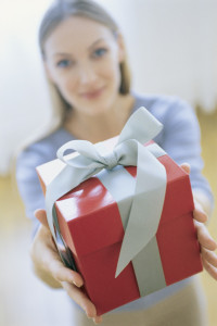 Woman Giving Gift, Portrait, Blurred.